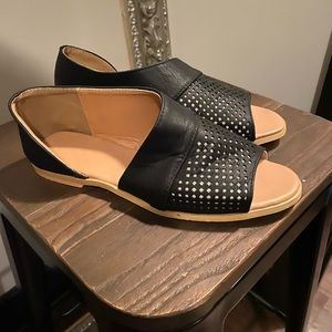 Black and tan cut out slip on